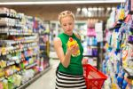 59126811 - beautiful caucasian woman shopping cleaners at supermarket.